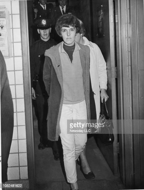 Valerie Solanas accused of shooting artist Andy Warhol arrives at a Manhattan precinct house for booking on June 3 1968