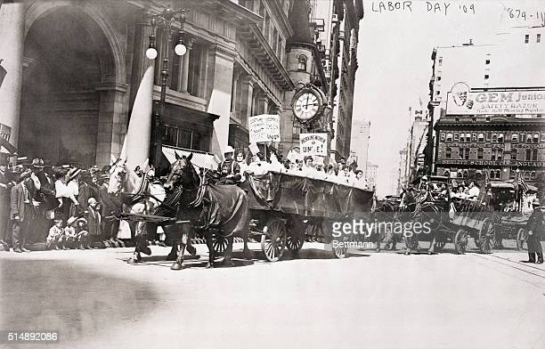 Workers of the International Ladies' Garment Workers' Union ride in horsedrawn carts during a Labor Day parade in New York City