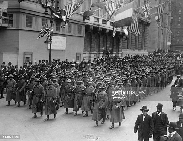 World War I The all black 15th regiment parading up Fifth Avenue New York City en route to an Army camp in New York State Undated photograph BPA
