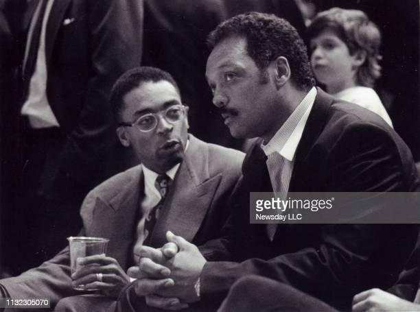 Filmmaker Spike Lee left and the Rev Jesse Jackson sit sidebyside at the New York Knicks basketball game at Madison Square Garden in Manhattan on...