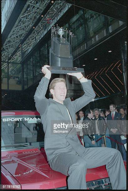 Orel Hershiser who pitched the Los Angeles Dodgers to world championship shows off MVP trophy and car presented to him October 28th by Sport Magazine...