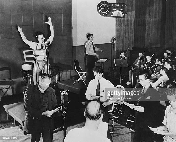 New York Orson WELLES rehearsing one of his radio programs on CBS During one of those he read Herbert George WELLS's book WAR OF THE WORLDS The...