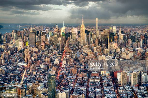 new york. panoramic view of downtown district at sunset - marco brivio stock pictures, royalty-free photos & images