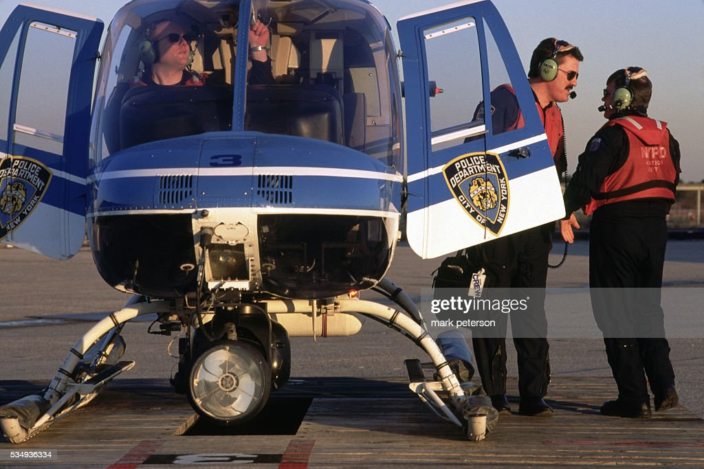 Nypd Aviation Unit Officers With Helicopter News Photo