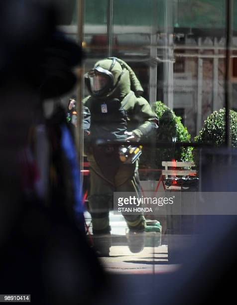 A New York Police Department bomb squad member stands after checking a green lunch cooler that was initially thought to be a suspicious package May 7...