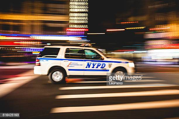 new york police department car in times square - new york city police department stock pictures, royalty-free photos & images