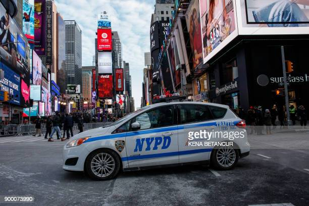 A New York Police Department car is parked in Times Square prior to New Year's Eve celebrations on December 31 2017 in New York City / AFP PHOTO /...