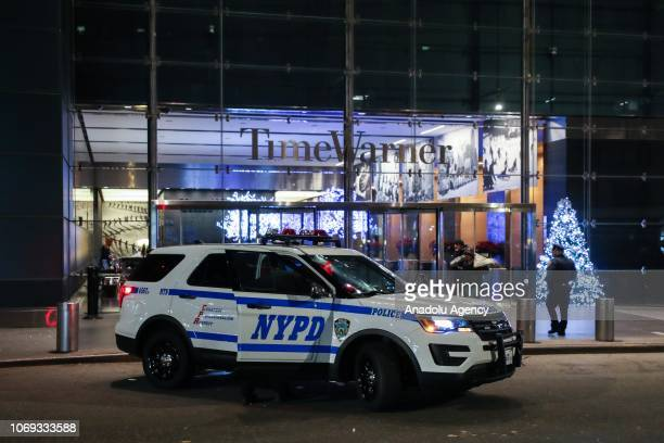 New York Police Department car is parked outside the Time Warner Center building where CNN's offices are after it was evacuated by police following a...