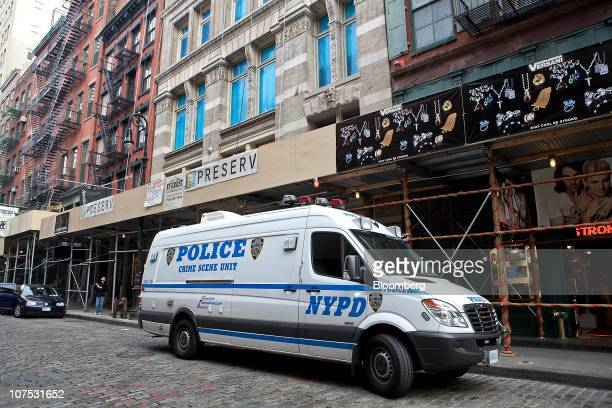 A New York Police Department Crime Scene Unit van sits parked outside the apartment building where Mark Madoff resided at 158 Mercer Street in New...