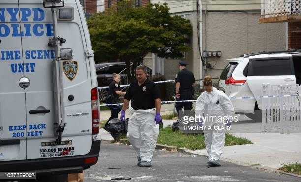 New York Police Department Crime Scene Unit walk out of a daycare center Mei Xin Care Incorporated located at the owners home in the Flushing area of...