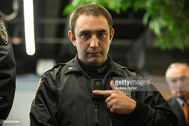 New York Police Department Officer Joshua Jones demonstrates how to use and operate a body camera during a press conference on December 3, 2014 in...
