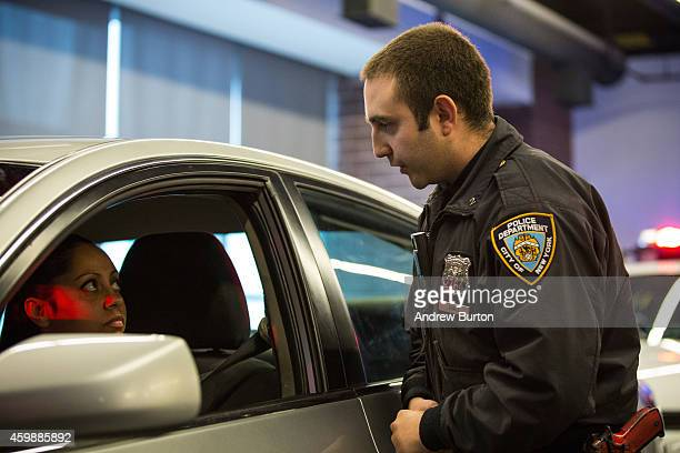 New York Police Department Officer Joshua Jones wears a body camera during a mock traffic stop to demonstrate how the cameras will be used during a...