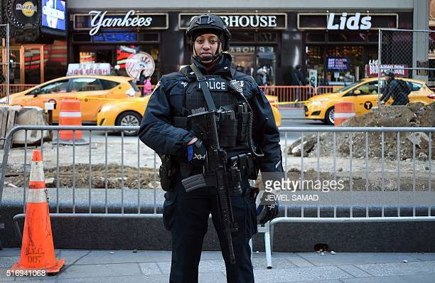 A New York Police Department officer patrols in Times Square on March 22 in New York New York and Washington stepped up security in the wake of the...