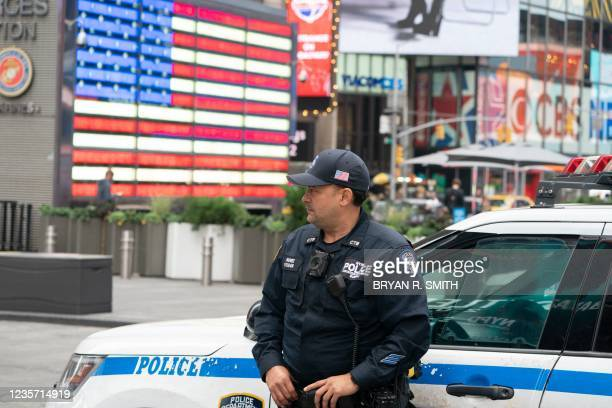 New York Police Department officer patrols Time Square on October 5, 2021 in New York.