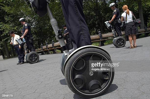 New York Police Department officers demonstrate the use of the Segway Human Transport to the news media in Central Park July 30, 2003 in New York...