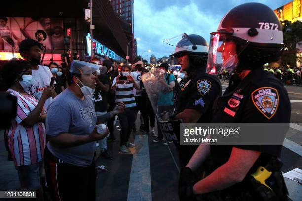 New York Police Department officers gather as activists hold a rally in response to the police killing George Floyd in front of Barclays Center on...