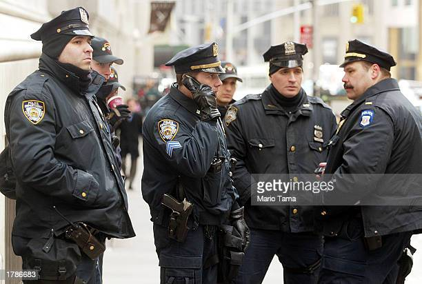 New York Police Department officers keep watch outside the New York Stock Exchange February 13 2003 in New York City Security has been heightened...