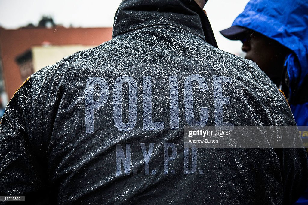 New York Police Department officers monitor a march against stop-and-frisk tactics used by police on February 23, 2013 in New York City. The march, which consisted of a few hundred people, started in the Bronx borough of New York and marched into the Harlem neighborhood of Manhattan.