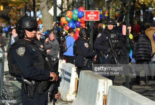New York Police Department officers patrol and secure crowds during the Macy's Parade balloon inflation November 22 2017 New York city is on high...
