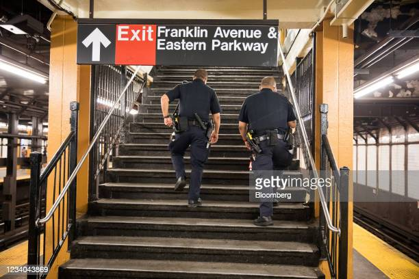 New York Police Department officers patrol in the Franklin Avenue subway station amid a rise of gun violence in the Brooklyn borough of New York,...