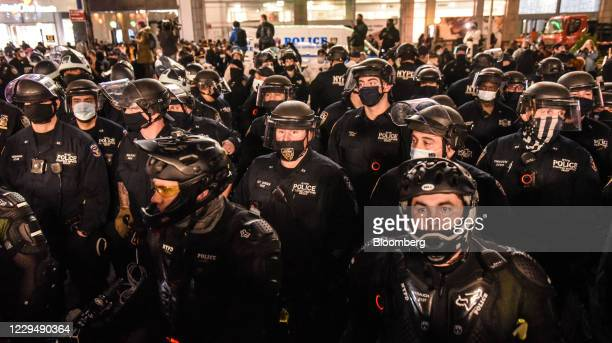 New York Police Department officers stand guard at a protest during the 2020 Presidential election in the Union Square neighborhood of New York,...