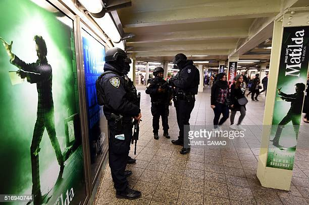 New York Police Department officers stand guard in a subway station on March 22 in New York New York and Washington stepped up security in the wake...