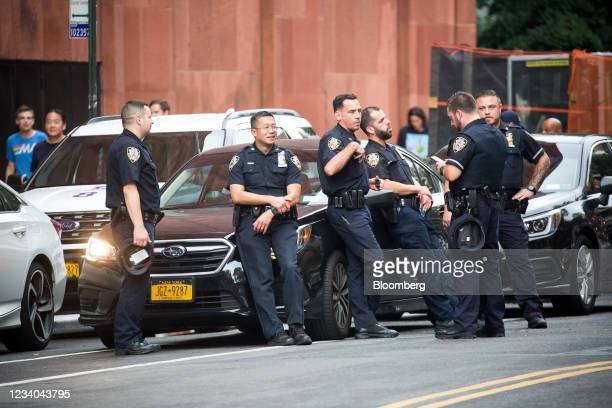 New York Police Department officers stand guard outside of Washington Square Park amid a rise of gun violence in New York, U.S., on Saturday, July...
