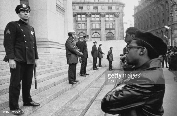 New York Police Department officers stand on the steps of the Foley Square Courthouse during a demonstration by the Black Panthers, in Foley Square,...