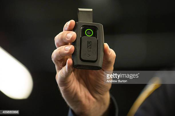 New York Police Department Sergeant Joseph Freer demonstrates how to use and operate a body camera during a media press conference on December 3 2014...