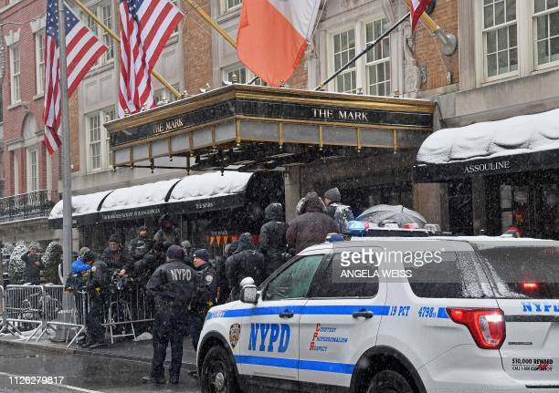 New York police officers and members of the press stand outside The Mark Hotel during Meghan Duchess of Sussex's baby shower on February 20 2019 in...