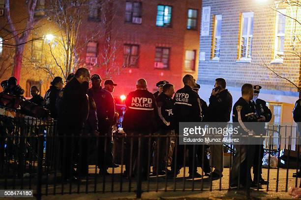 New York Police Officers arrive to the scene of a shooting in a building on February 4 2016 in the Bronx in New York City Two NYPD officers were shot...