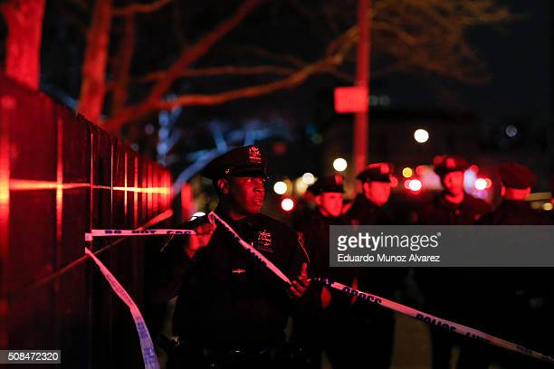 New York Police Officers secure the area near the scene of a shooting in a building on February 4 2016 in the Bronx in New York City Two NYPD...