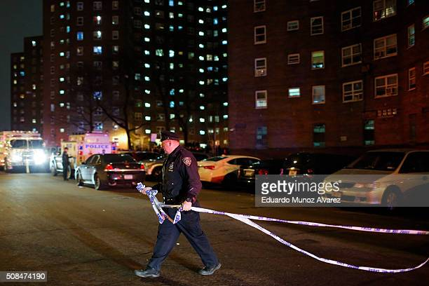 New York Police Officers secures the area near the scene of a shooting on February 4 2016 in the Bronx in New York City Two NYPD officers were shot...
