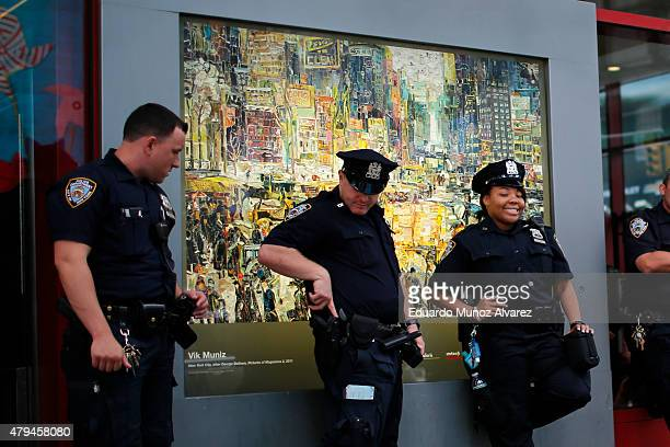 New York Police Officers stand guard at Times Square subway station on July 4 2015 in New York City Security was heightened with more than 7000 NYPD...