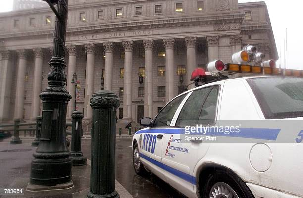 New York Police vehicle sits by the federal courthouse February 5 2001 in New York City The protection is part of $12 million of improved security at...