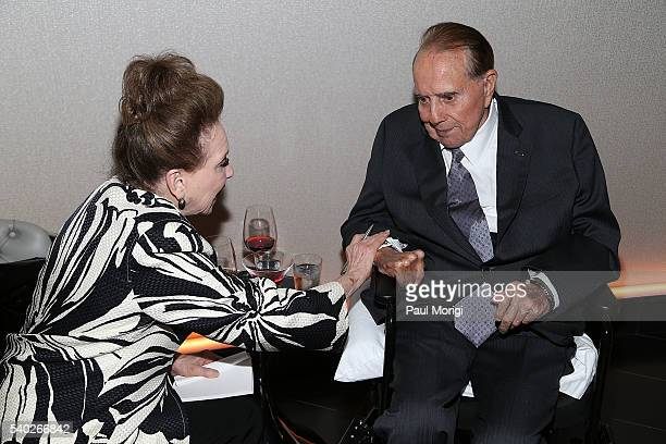 New York Post columnist Cindy Adams talks with former Sen Bob Dole at the grand reopening party of the iconic Watergate Hotel on June 14 2016 in...