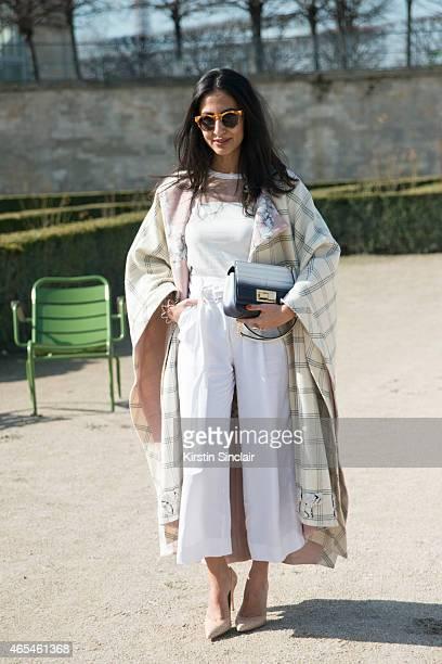 552bea7848 New York Post fashion writer Nausheen Shah wears Westward Leaning  sunglasses Johann Ortiz coat Elie Saab