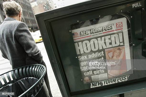 New York Post front page refers to the scandal involving New York Governor Eliot Spitzer on March 12, 2008 outside the governor's New York City...