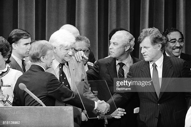 President Carter and Sen Edward Kennedy finally shake hands as Democratic Convention chairman Thomas 'Tip' O'Neill and carter campaign manager Robert...