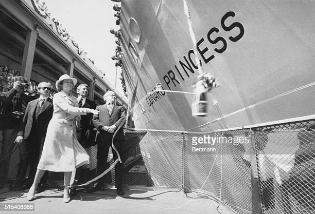 New York: Princess Grace of Monaco hurls champagne bottle towards the new cruise liner Cunard Princess, christening the vessel in New York Harbor....