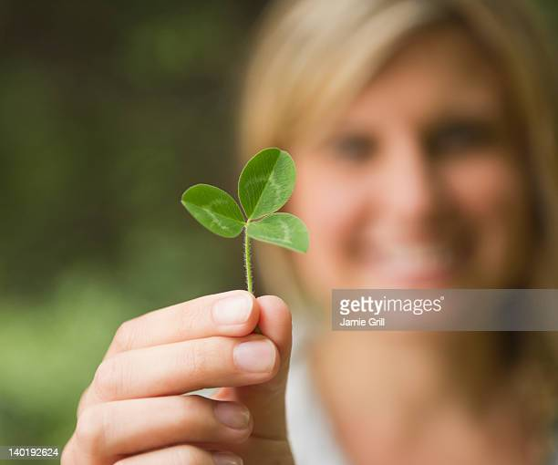 USA, New York, Putnam Valley, Roaring Brook Lake, Close up of woman's hand holding clover