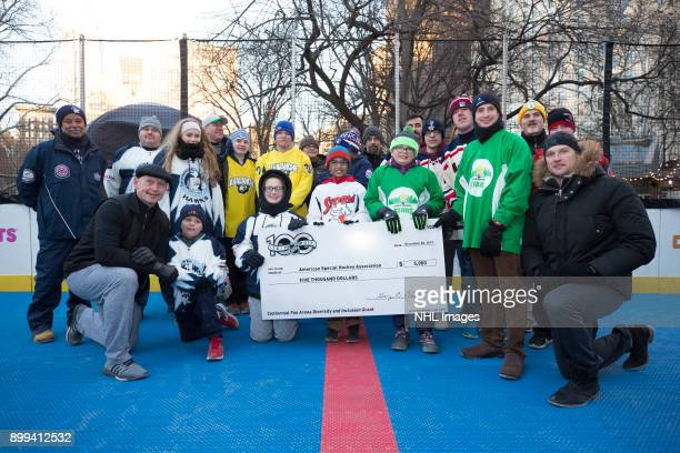 New York Rangers alumni Adam Graves and Colton Orr help present a five thousand dollar grant check to a group from the local Connecticut chapter of...