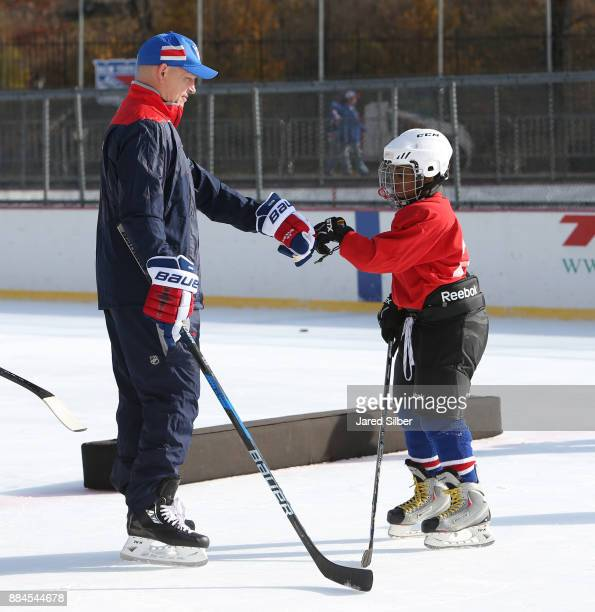 New York Rangers Alumni Adam Graves skates with kids from Ice Hockey In Harlem during the New York Rangers youth hockey clinic prior to the teams...