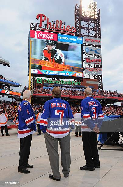 New York Rangers alumni Ed Giacomin Rod Gilbert and Harry Howell watch the video on the jumbotron before the start of the Alumni game prior to the...