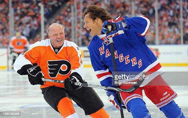New York Rangers alumni Ron Duguay laughs as he plays against alumni Bob Kelly of the Philadelphia Flyers during the Alumni game prior to the 2012...