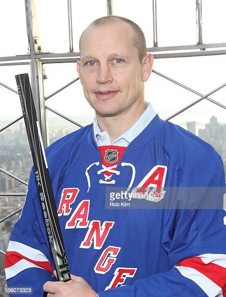 New York Rangers alumnus Adam Graves visits The Empire State Building in celebration of the 2012 Bridgestone NHL Winter Classic on December 22 2011...