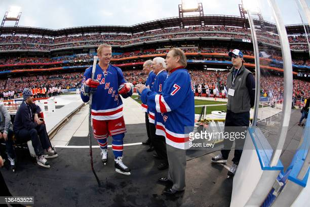 New York Rangers Brian Leetch and ambassadors Harry Howell Ed Giacomin and Rod Gilbert and prior to the game against the Philadelphia Flyers at...