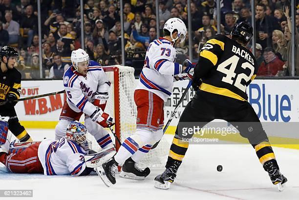 New York Rangers center Brandon Pirri prevents Boston Bruins center David Backes from the chance on New York Rangers goalie Antti Raanta on November...
