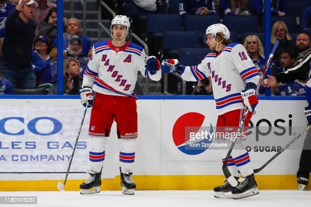 New York Rangers center Chris Kreider celebrates with New York Rangers center Artemi Panarin after scoring a goal in the 1st period of the NHL game...