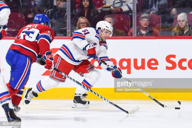 New York Rangers Center David Desharnais tries to escape Montreal Canadiens Defenceman Victor Mete with the puck during the New York Rangers versus...